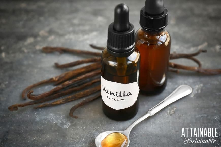 brown bottle of homemade vanilla with vanilla beans