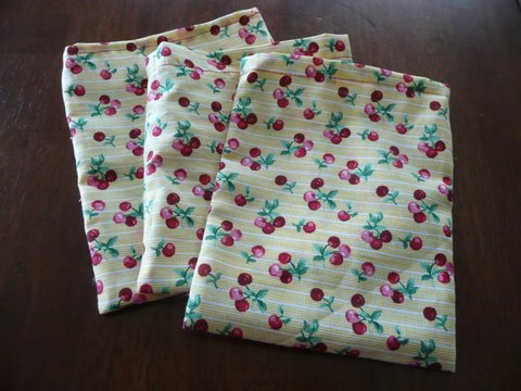 three homemade cloth bags, stacked