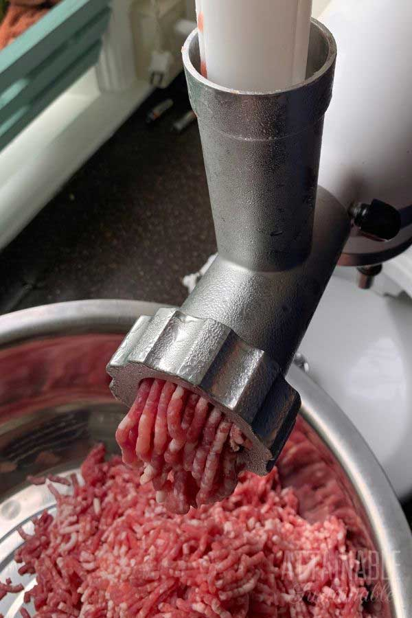 grinding pork with a meat grinder