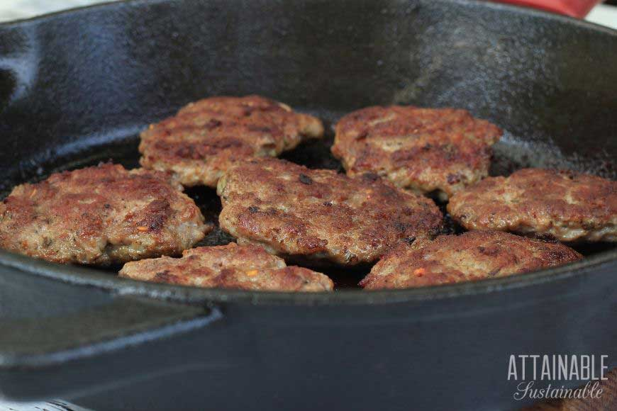 meat patties in a cast iron pan