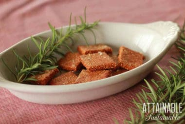 gluten free cracker recipe finished and in an oblong white dish with a sprig of rosemary