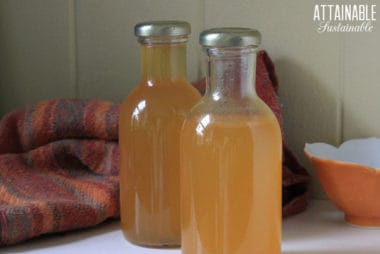 homemade simple syrup in two glass jars