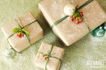 3 square gifts wrapped in brown paper with green ribbon