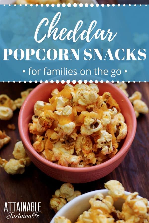 cheddar popcorn snacks in a pink bowl