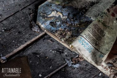 open magazine burned on wood floor