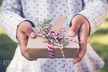 christmas gift for kids, held by child's hands