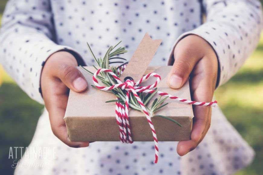 christmas gifts for kids, nicely wrapped and held by child's hands