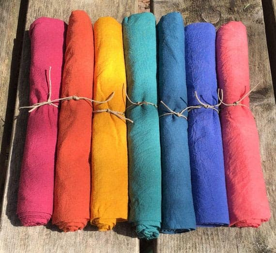 rainbow colored play silks on a wooden deck - perfect gifts for kids