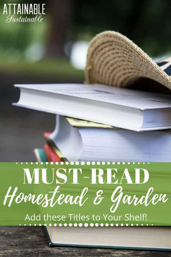stack of books outside, with a straw hat - garden books