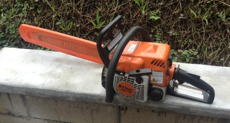 chainsaw on a concrete bench