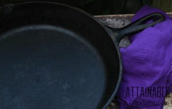 cast iron skillet with a purple towel