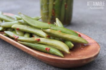 fermented snap peas in a wooden dish