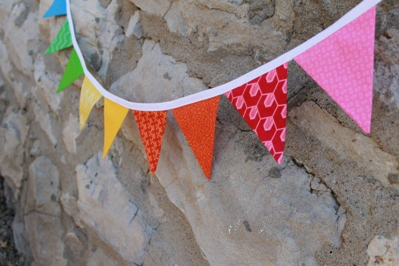 colorful fabric banner on a rock wall