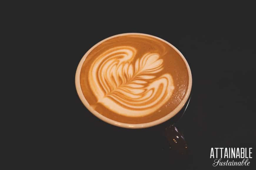 fancy coffee art on a latte, dark background