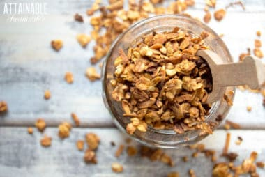 healthy granola recipe in a glass jar with wooden scoop