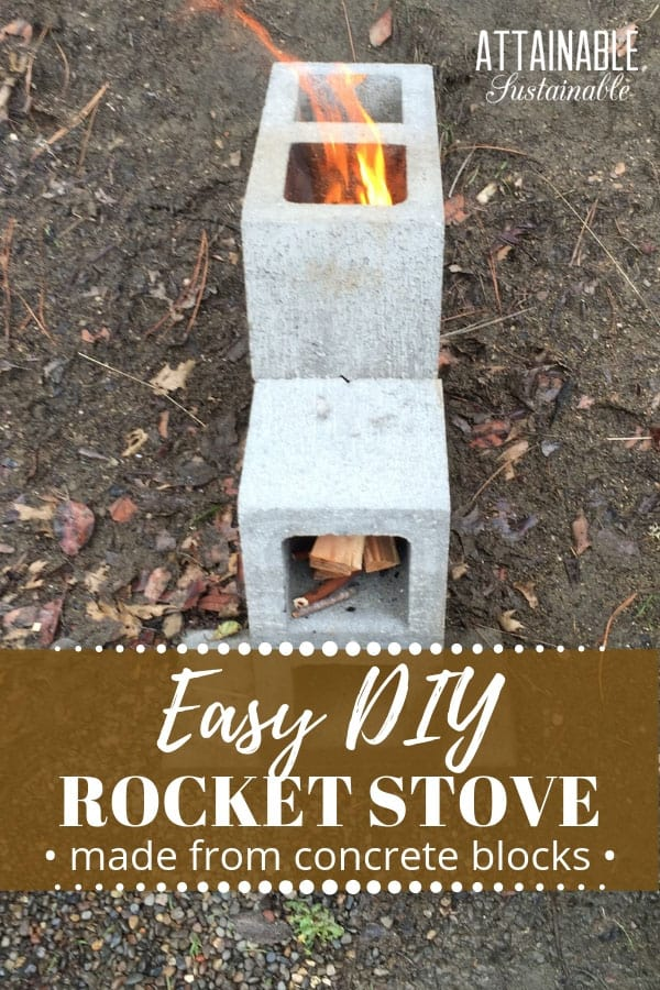 concrete block rocket stove with flame showing