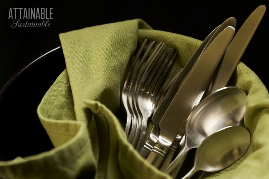 real silverware on green cloth napkin -- green living tips!