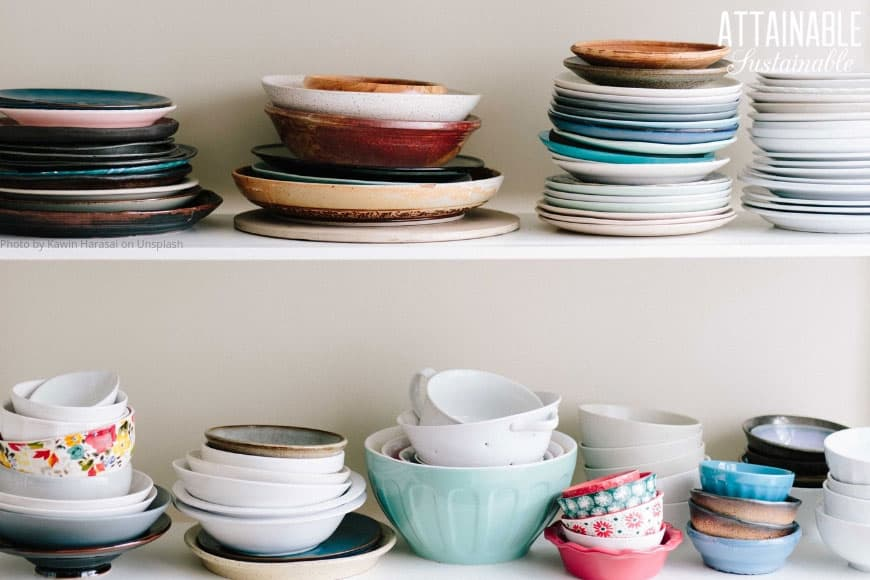 two shelves full of brightly colored stacked plates, assorted colors