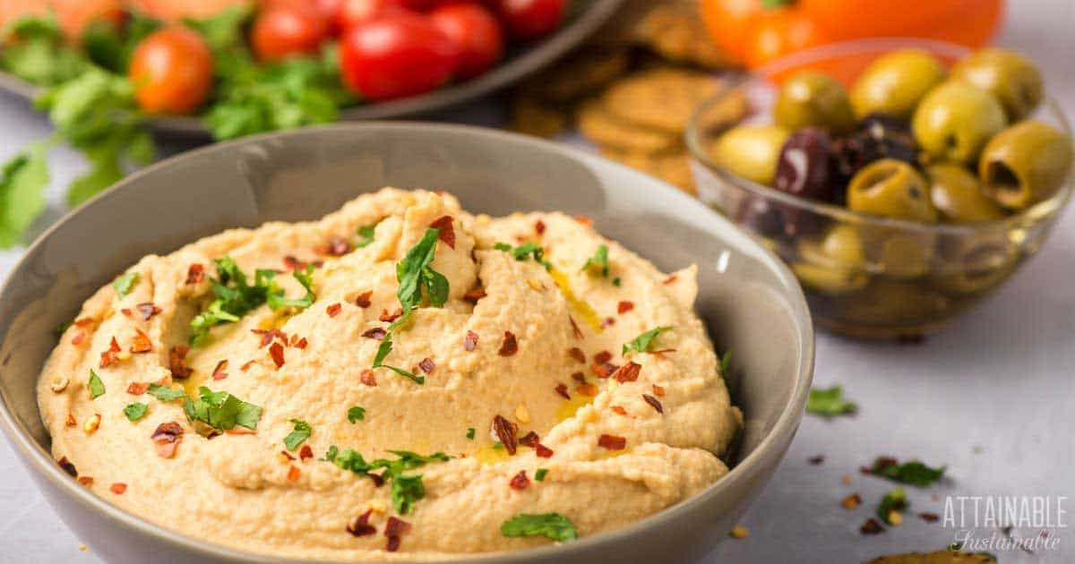 hummus in a brown bowl