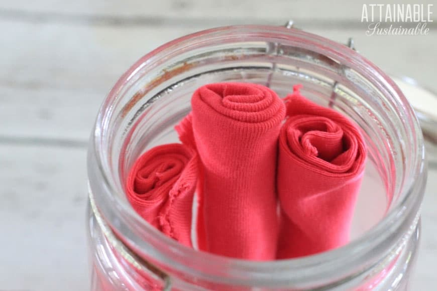 homemade dryer sheets (pink) in a glass jar