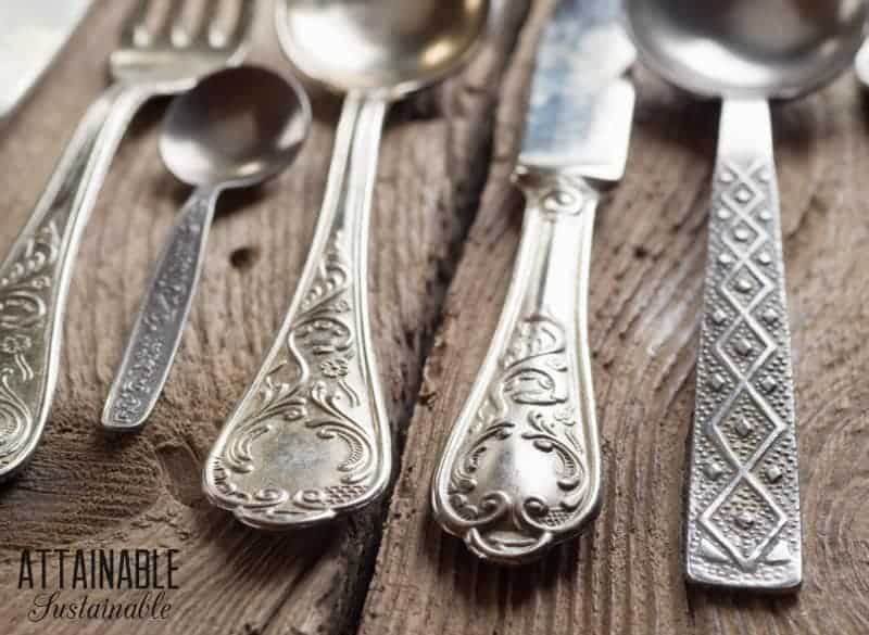 close up of silverware on a wooden table