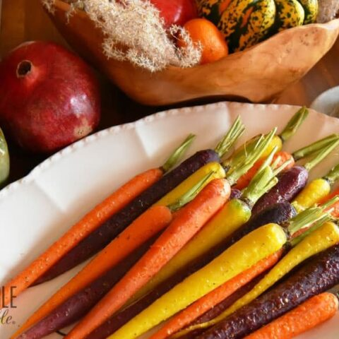 rainbow carrots, roasted and served on a white platter