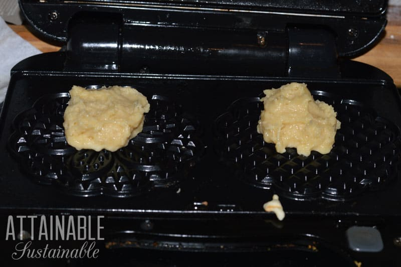 dough in black pizzelle iron