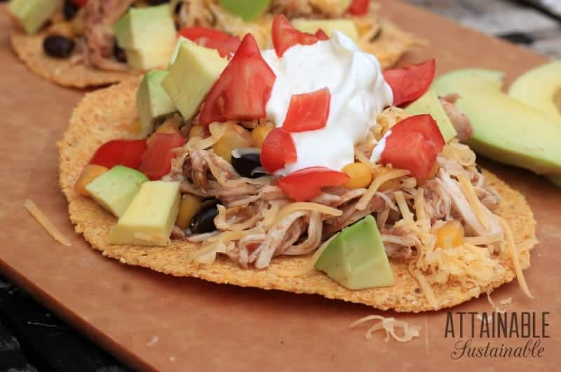 This chicken tostada recipe takes less than ten minutes to put together in a slow cooker. Start it before work and dinner will be ready when you get home!