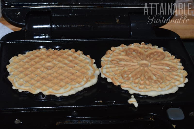 cooked pizzelles in pizzelle maker