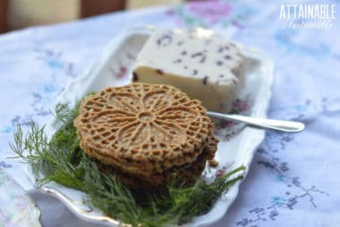 pizzelle recipe made and plated on a floral plate with cheese