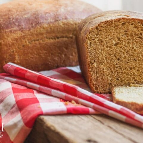 homemade sandwich bread with a red checked tablecloth
