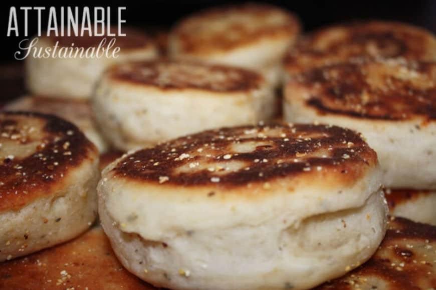 homemade sourdough english muffins on a baking sheet