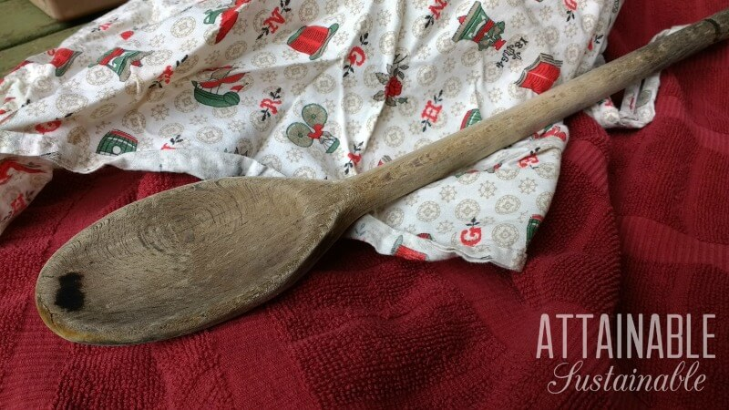 Heavy duty wooden spoon on a red background. One of my essential kitchen tools