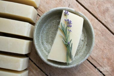 homemade soap in a pale green pottery dish with lavender flower