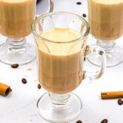 three glass mugs full of pumpkin spice latte