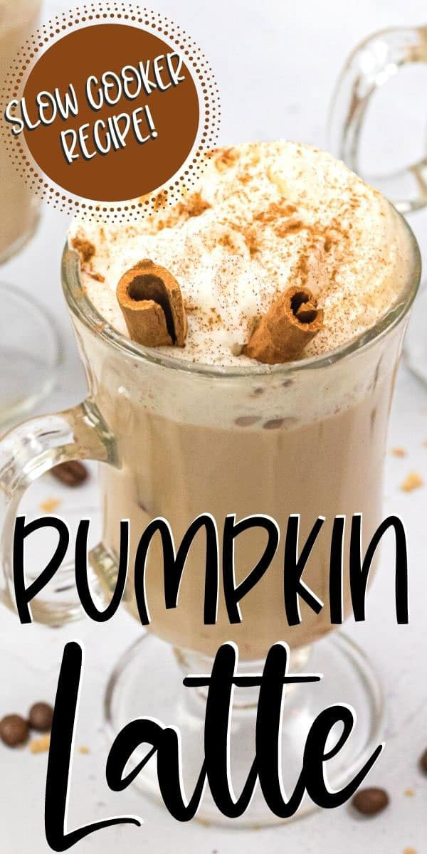 pumpkin spice latte with cinnamon stick in a glass mug