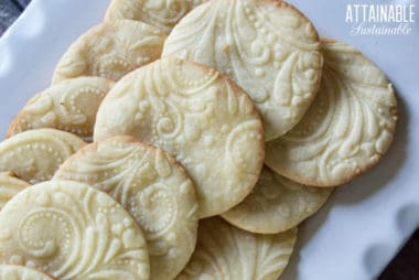 homemade sugar cookies on a white platter.