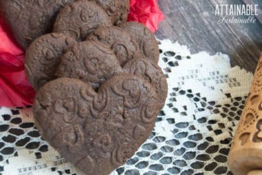 heart chocolate sugar cookies on a doily
