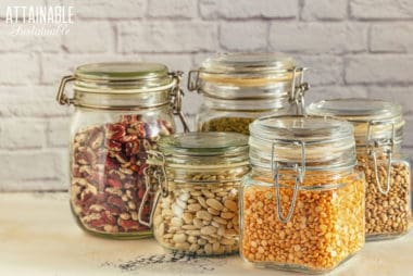 wire bail pantry storage containers - glass wire bail jars full of dry items like beans and popcorn