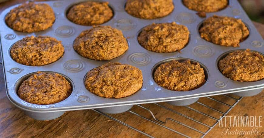 muffin tin full of baked vegan sweet potato muffins