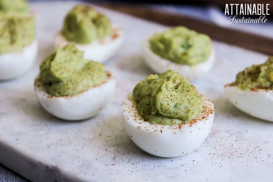 Deviled eggs with green avocado filling