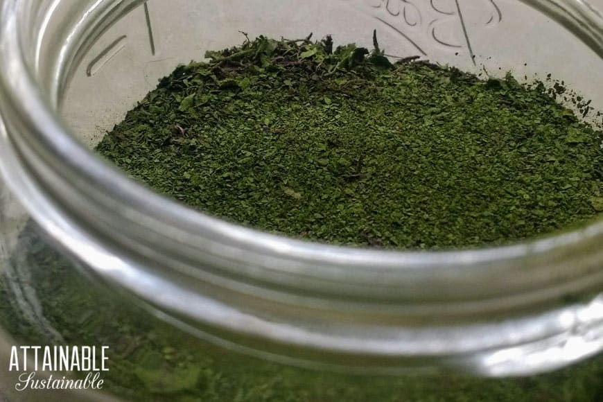green powder in a glass jar