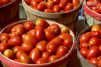 roma tomatoes in a wooden basket