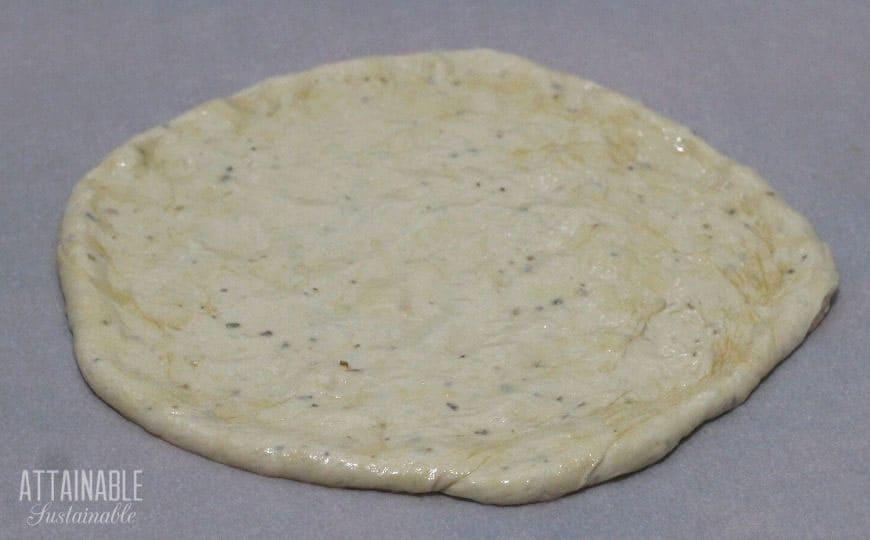 raw pizza dough round
