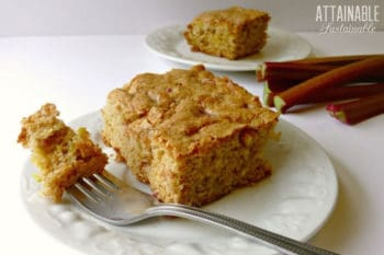rhubarb coffee cake on a white plate with a fork