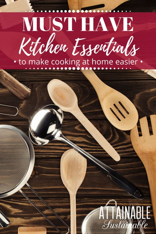 wooden spoons and other kitchen essentials on a wooden background