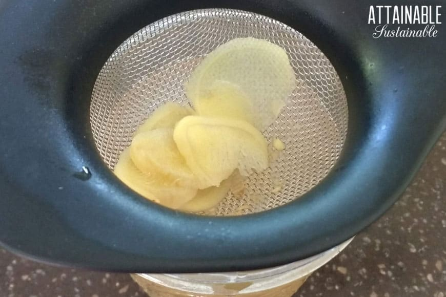 cooked ginger slices in a small strainer
