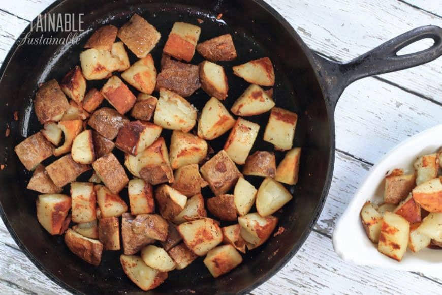browned potatoes in a cast iron pan from above