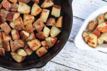 fried red potatoes in a cast iron pan from above