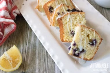 lemon blueberry loaf cake sliced on a rectangular white plate
